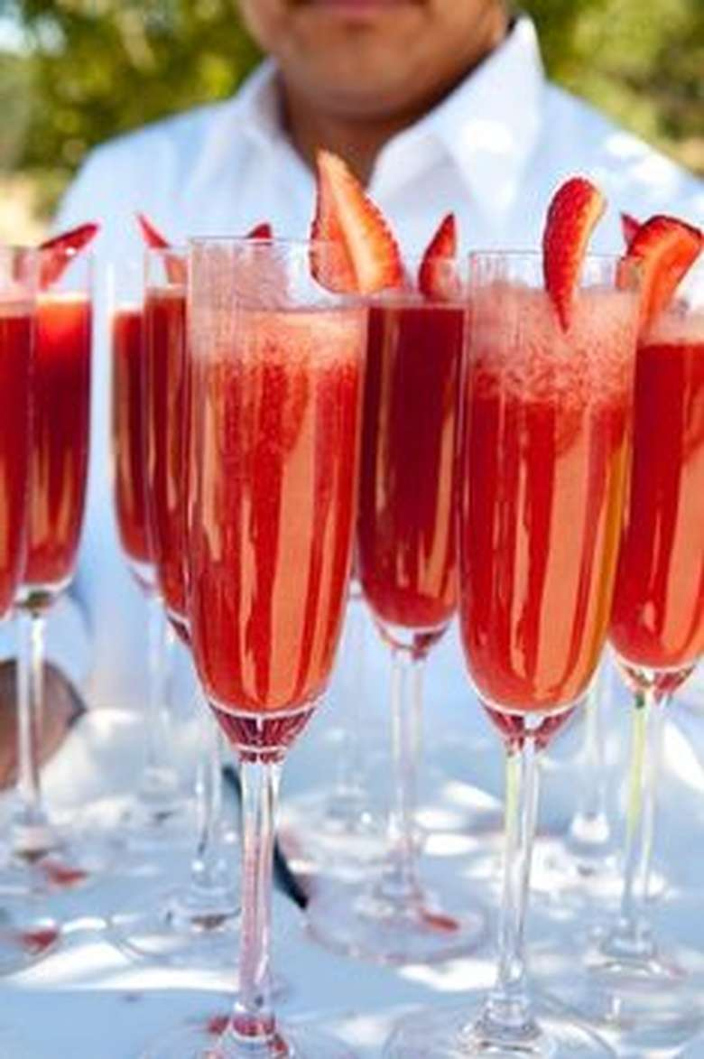 champagne flutes filled with strawberry daquiris