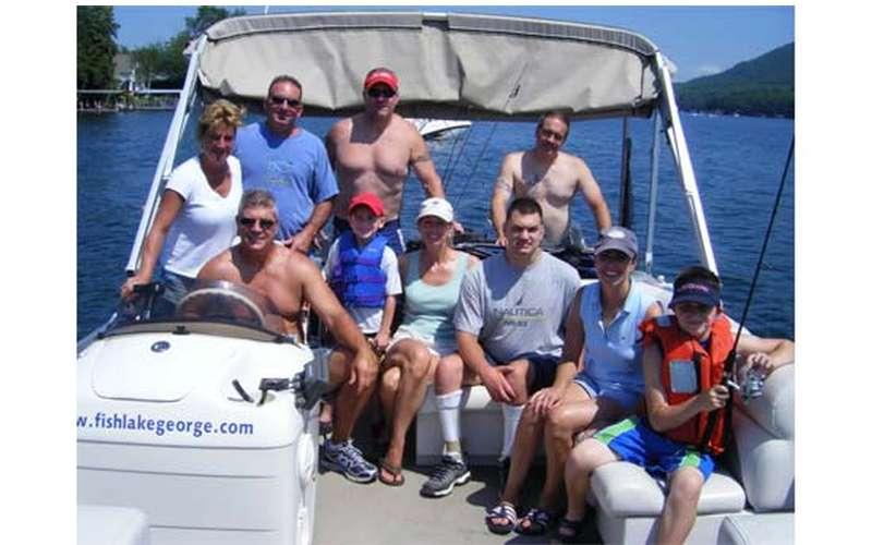 Boat full of people in Lake George