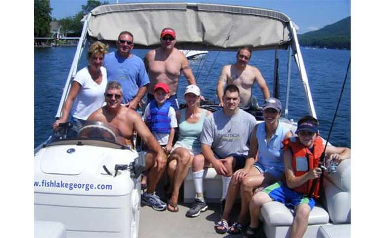 Boat full of people in Lake George