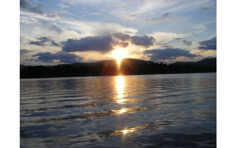 Sunset over Lake George, behind the mountains