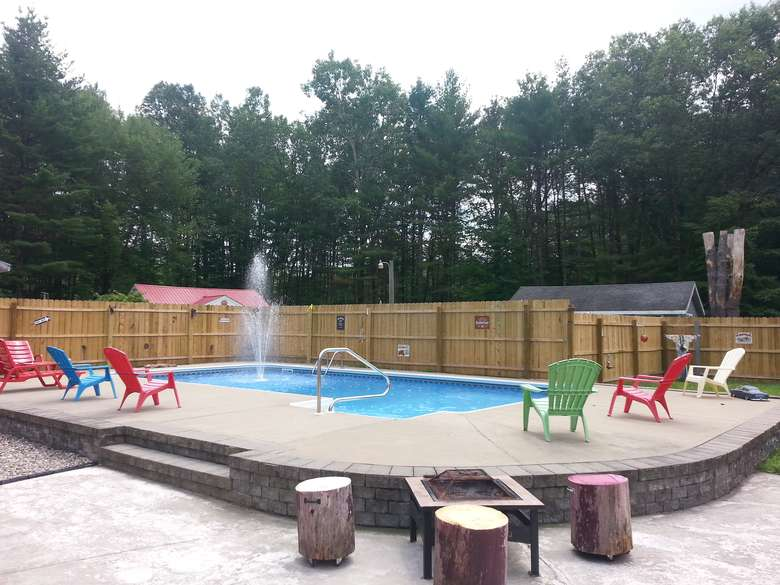 outdoor pool with colorful pool chairs