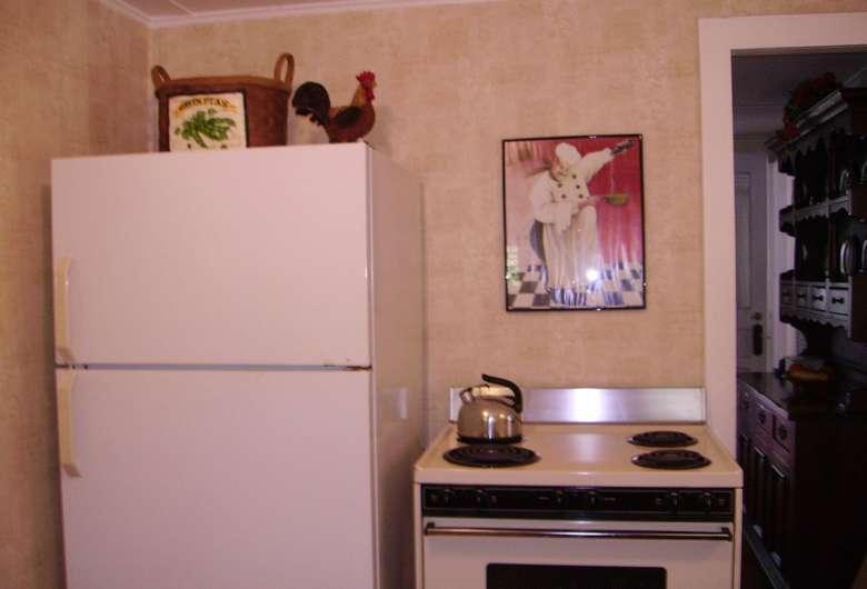 a white fridge next to an oven