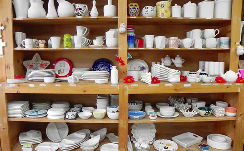 shelves full of pottery ready for painting