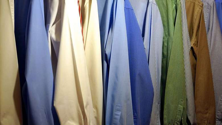 row of different colored dress shirts