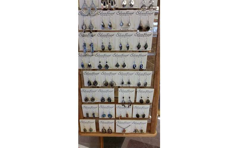 a display of several pairs of earrings