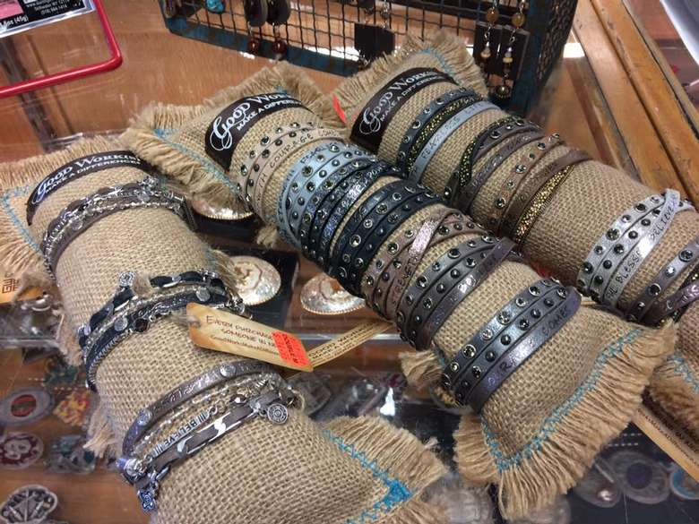 metal, western-themed bracelets on display