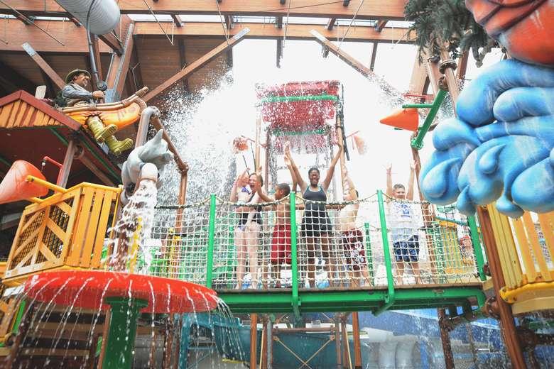 people splashing around in an indoor waterpark