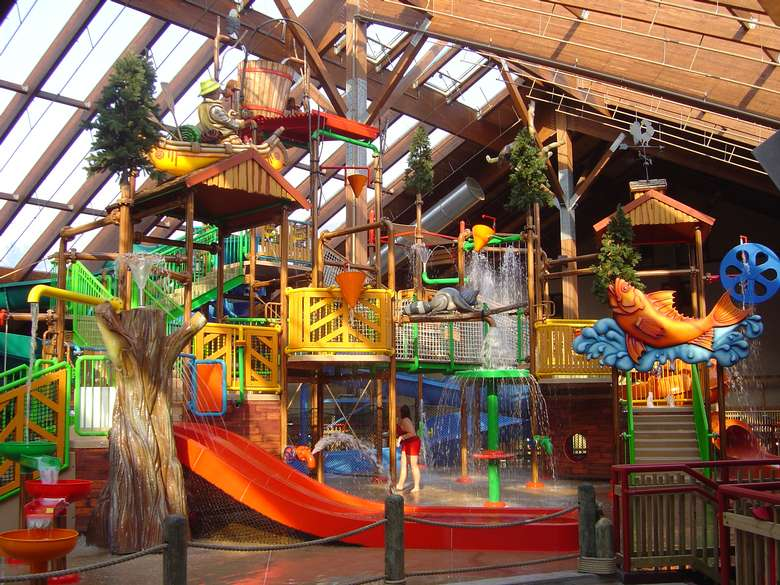 indoor waterpark with waterslides and sprayers