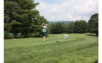 golfer in mid-swing