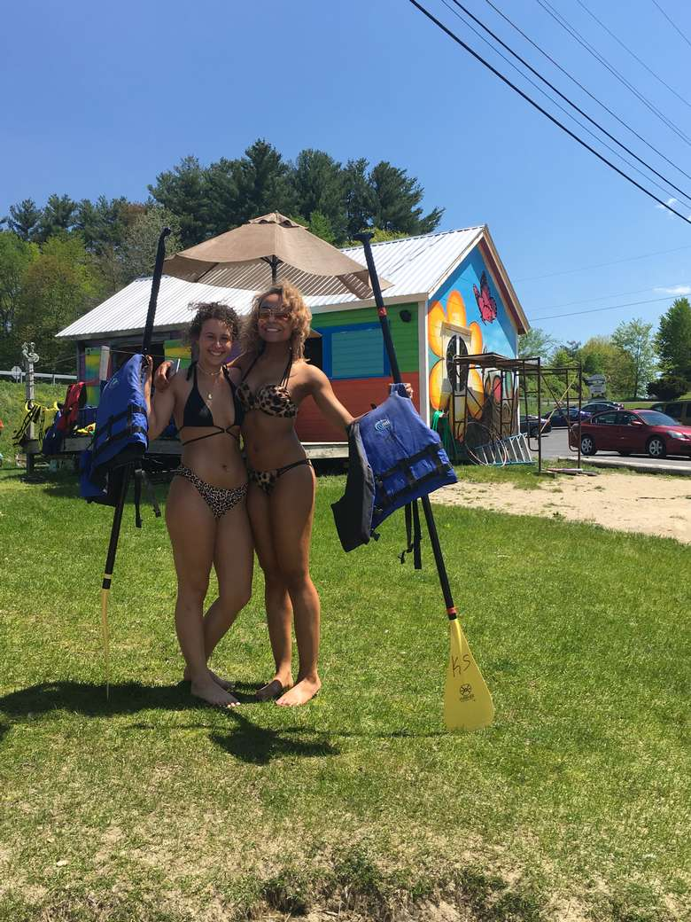 two girls posing with SUP paddles