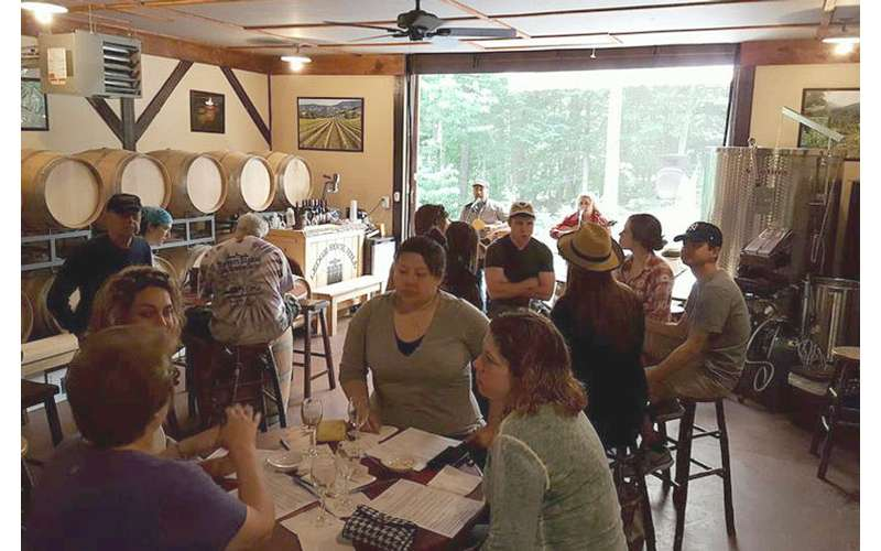 crowded tasting room at ledge rock hill winery