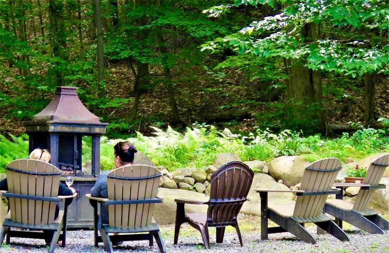 fireplace and outdoor seating in the adirondacks at ledge rock hill winery