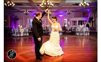 groom twirling bride on the dance floor