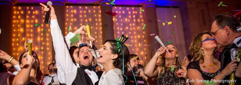 bride, groom, and guests dancing