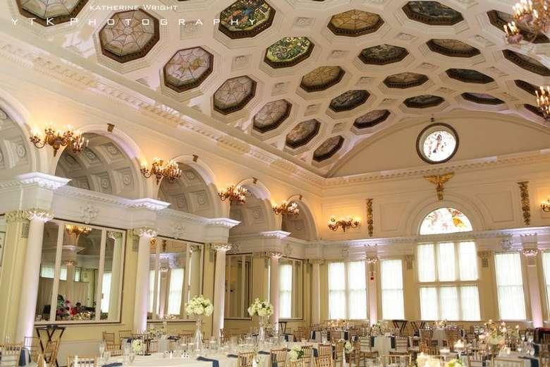 an elegant ballroom set up for a wedding