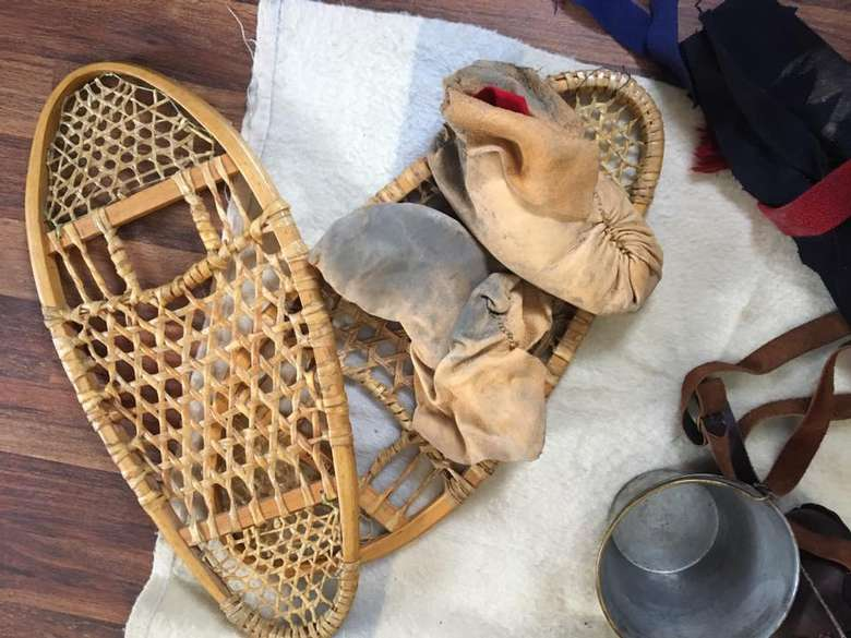 wooden snowshoes and old outdoor gear