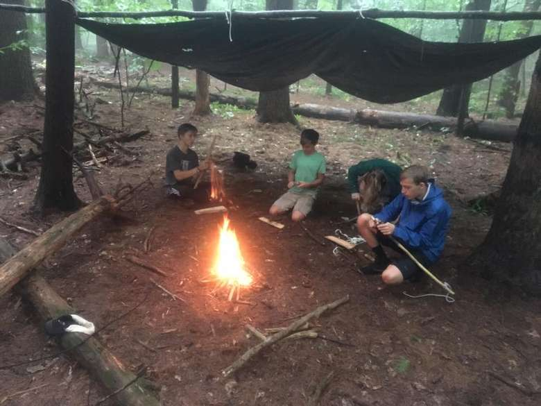 kids working around a campfire