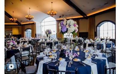 a dining area set up for a wedding