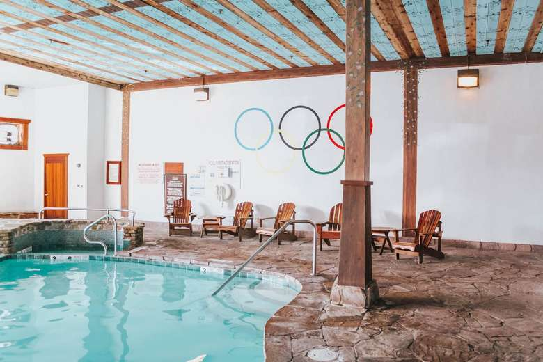 indoor pool with Olympic rings painted on the wall
