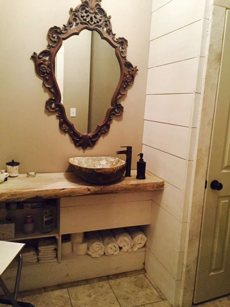 an old fashioned mirror in a bathroom