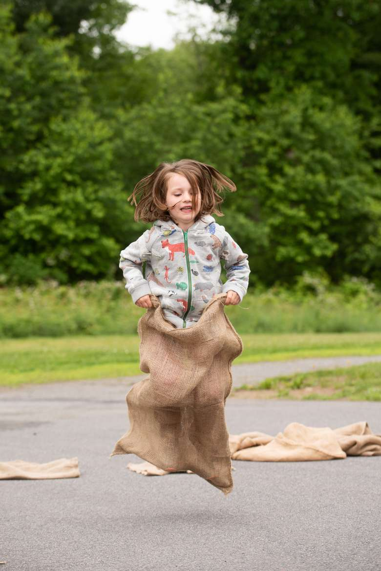 girl participating in a potato sack race