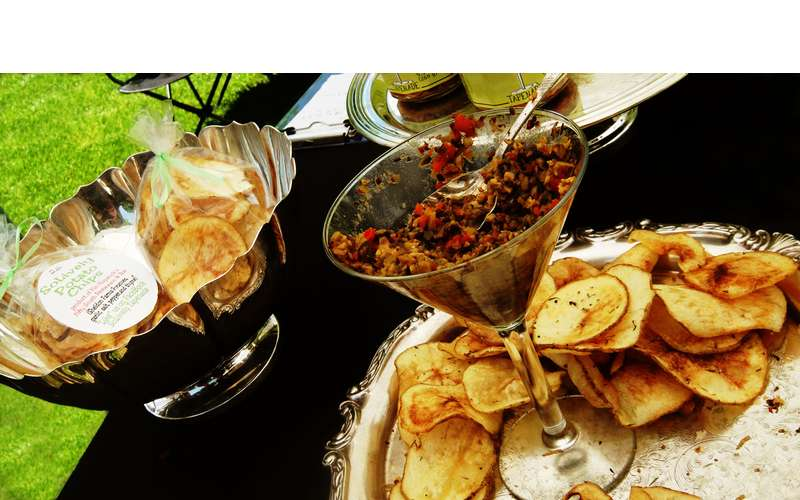 chips and salsa in a martini glass on a table
