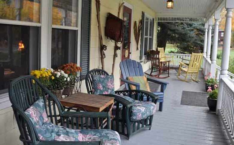large welcoming front porch with comfortable seating arrangements