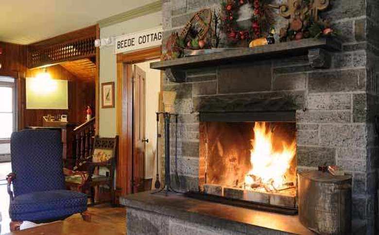 large stone fireplace with roaring fire