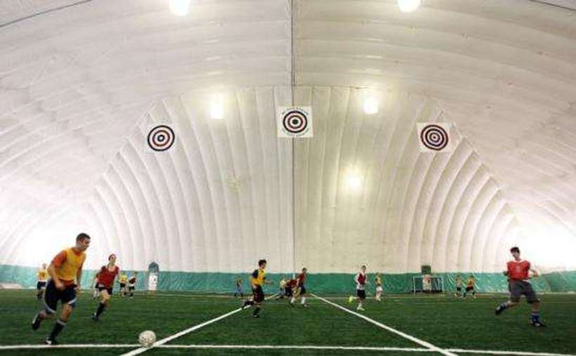 teams playing indoor soccer in an enclosed dome