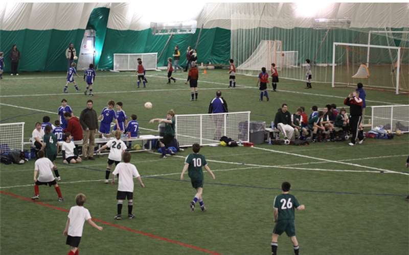 soccer players on an indoor field