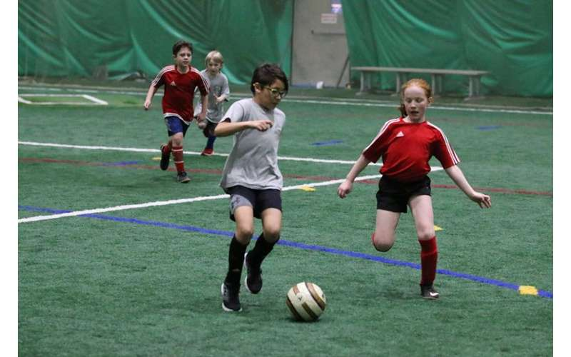 kids playing indoor soccer