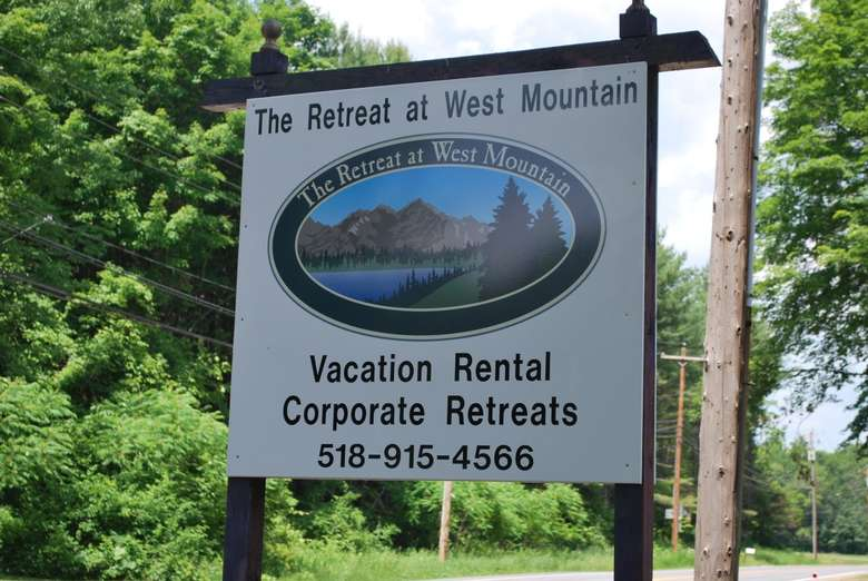 sign that says the retreat at west mountain vacation rental corporate retreats