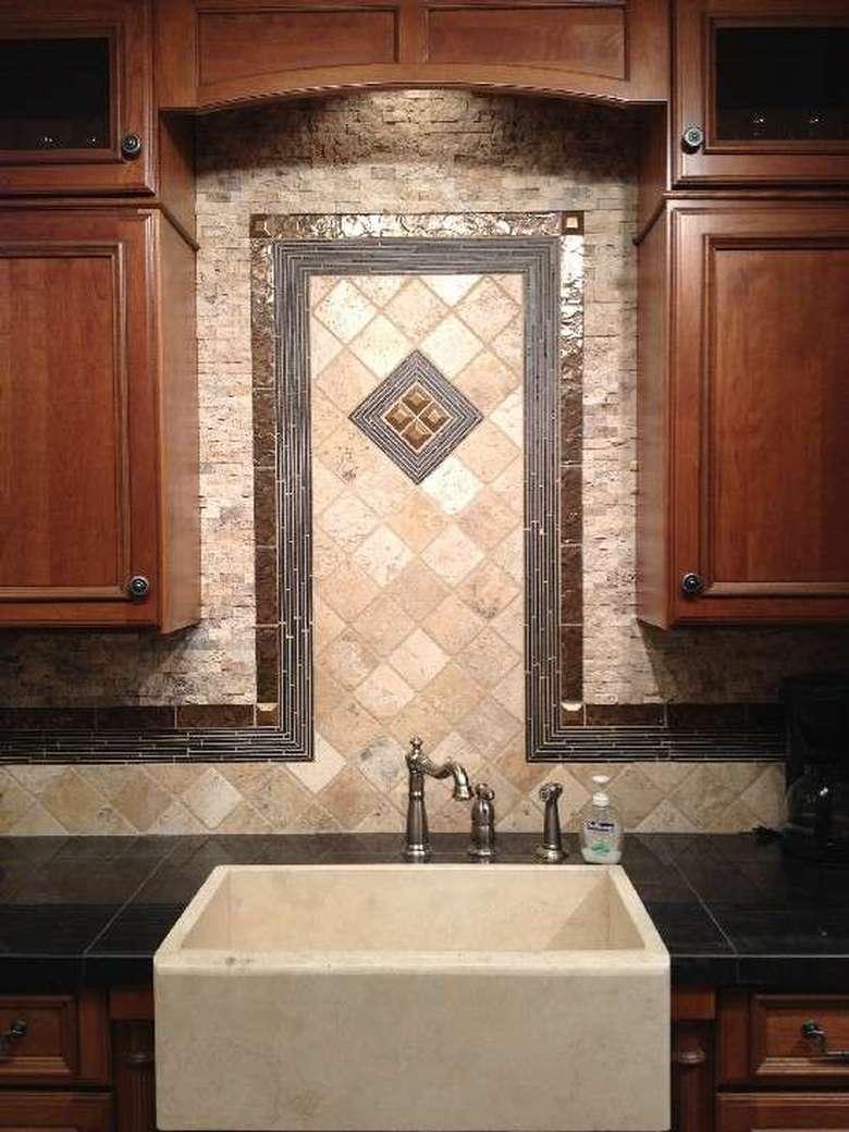 tiled backsplash behind a kitchen sink
