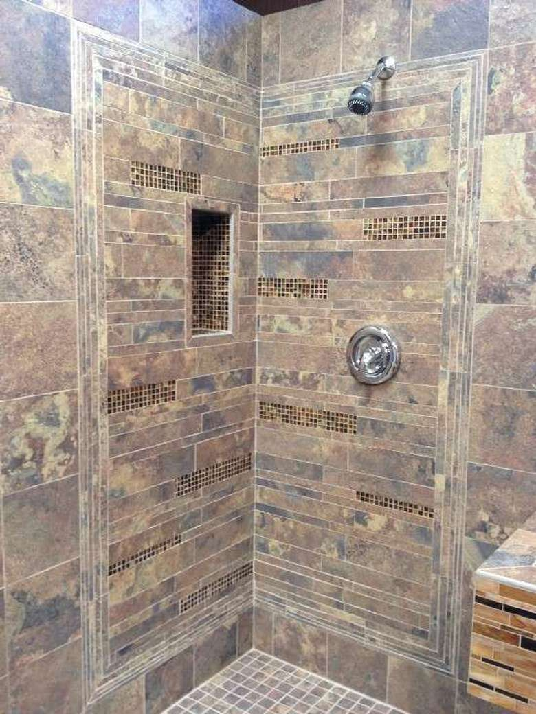 a shower with a mix of tiles and stone