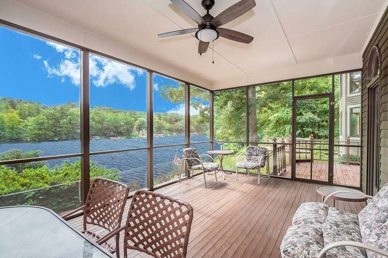 indoor porch area with a view of the water