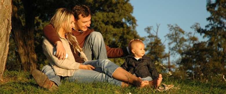 man, woman, and toddler