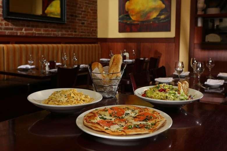 pasta, pizza, salad, bread on table