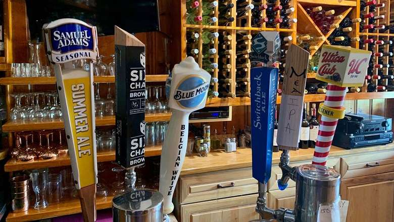 draft beer taps at a bar