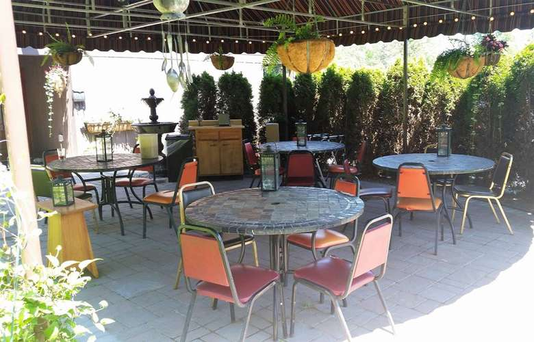round tables and some chairs in a patio