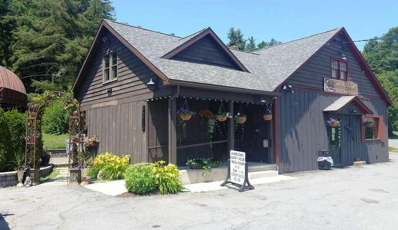 exterior of a dark brown restaurant