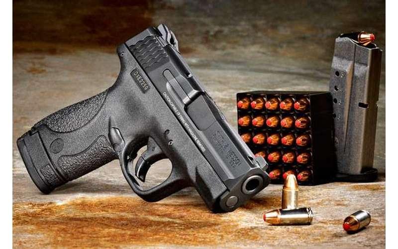 a gun with gun supplies
