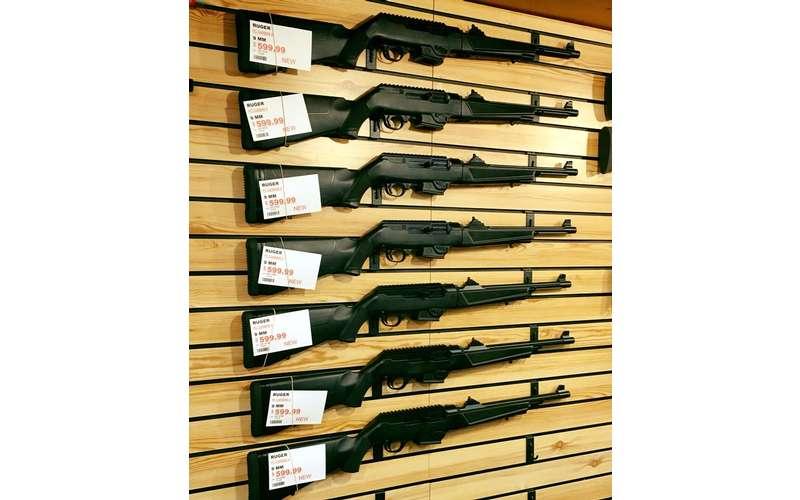 guns hanging on a wall