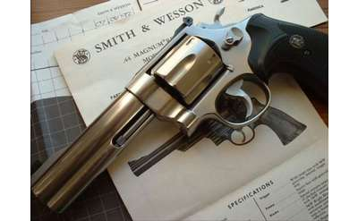 a gun on top of Smith & Wesson papers