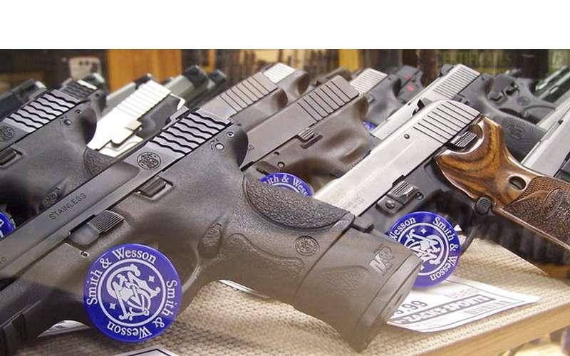 guns behind a case