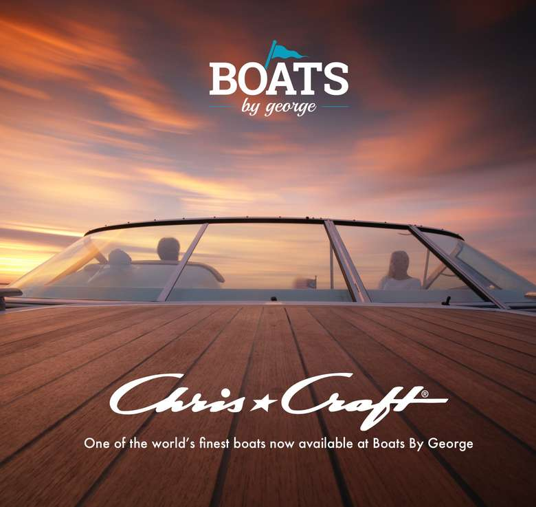 boats by george and chris craft logos with a boat windshield at sunset