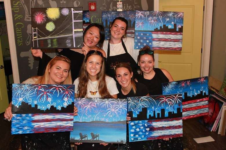 group of girls with paintings of fireworks