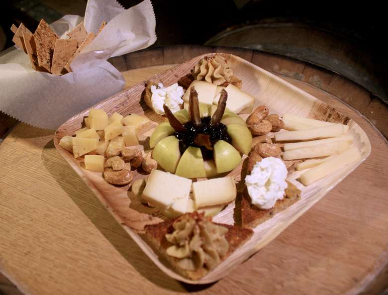 cheese plate with different types of cheeses and crackers