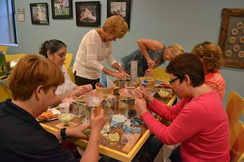 group of women making their own candles