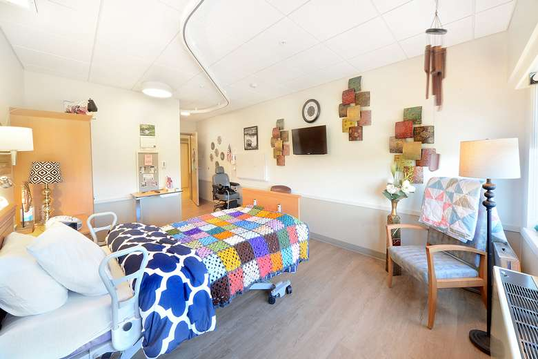 Bedroom within 5 Springs of Wesley Health Care Center