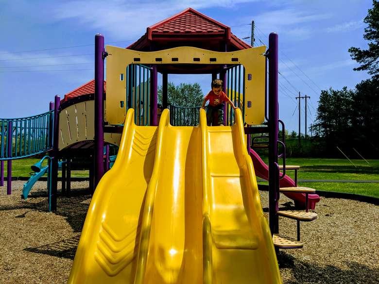 kid and slides